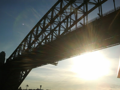 Sun shining through Sydney harbour bridge