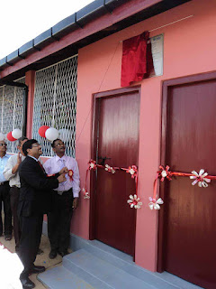 Neeraj Garg - Vice President, South West Asia & Juice Business, Coca-Cola India & South West Asia Business Unit; unveiling the commemorative plaque to open the Navalar pre school in Batticaloa
