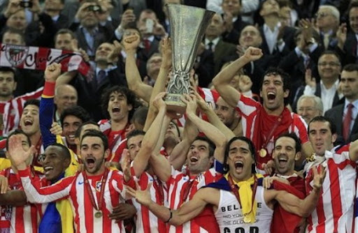 Atlético Madrid players celebrate with the trophy after winning the Europa League