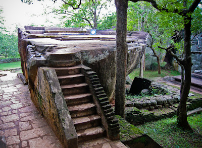 Sigiriya Throne Room, stone throne-sofa, carved entirely from sticking granite rock, ideal smooth and flat ground before the throne