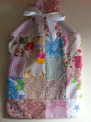 Hot water bottle with patchwork cover