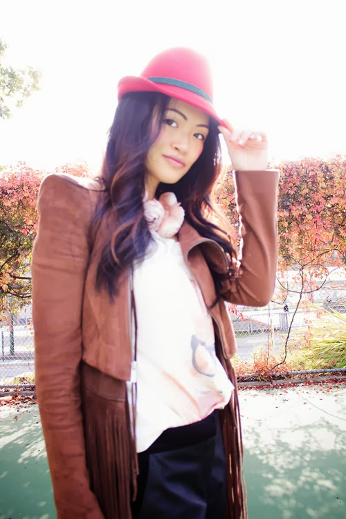 Vancouver Fashion Blogger Jasmine Zhu wearing Bavarian hat, bunny shirt, leather pants, leather jacket, Vanlaced Avenue Dorcia Glitter Bag