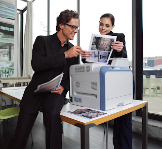 man woman office workers using printer