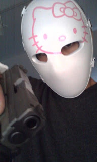 Weird and creepy Hello Kitty bullet proof face mask and gun