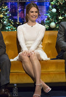 We find now flawless in a white mini dress, Lily James, 26, took advantage of the evening to reveal her amazing sculpted body and long legs on Saturday, December 19, 2015 at the Jonathan Ross show in London.