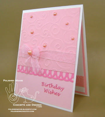 Front of my handmade girly pink birthday card sitting at a left angle.