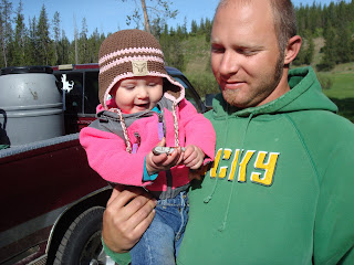 My daugher holding a fish