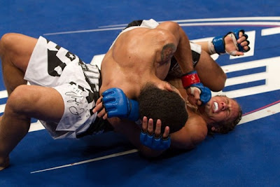 Jose Aldo with Urjiah Faber in mounted crucifix, pounding away