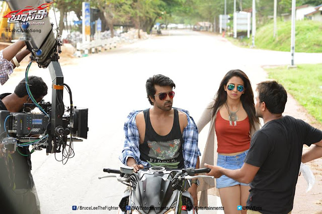 Rakul Preet Singh latest images in Bruce Lee movie, Ram Charan and Rakul Preet Singh latest pics in Bruce Lee movie, Ram Charan latest movie Hq stills, Ram Charan and Rakul Preet Singh latest images in Bruce Lee movie
