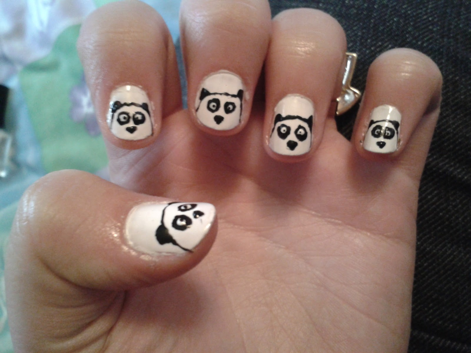 And here's me wearing the lovely panda ring i bought from New Look:
