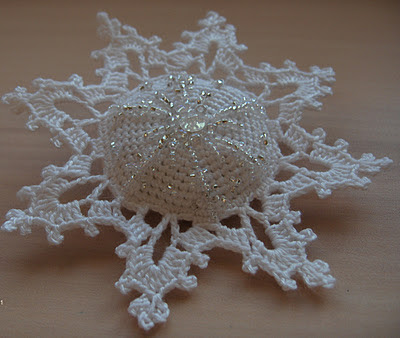 3d hand crocheted snowflakes decorated with glass beads