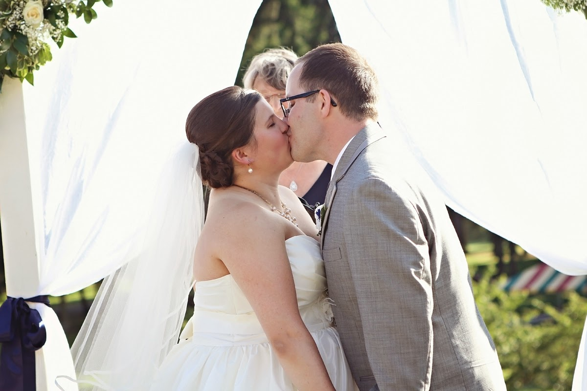 Nate and Molly kiss to seal their vows - Patricia Stimac, Seattle Wedding Officiant