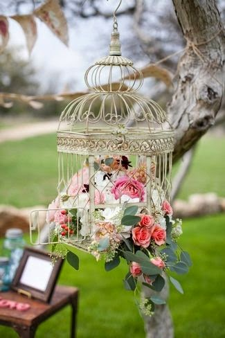 vintage style birdcage with flowers