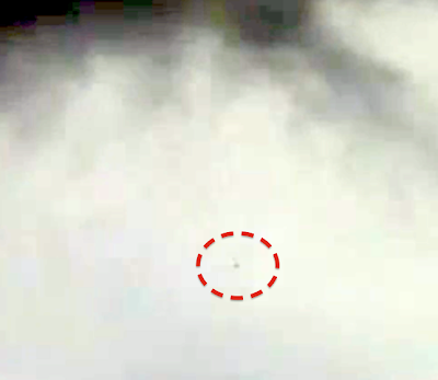 Dark UFO Caught Exiting Storm Clouds, UFO Sightings