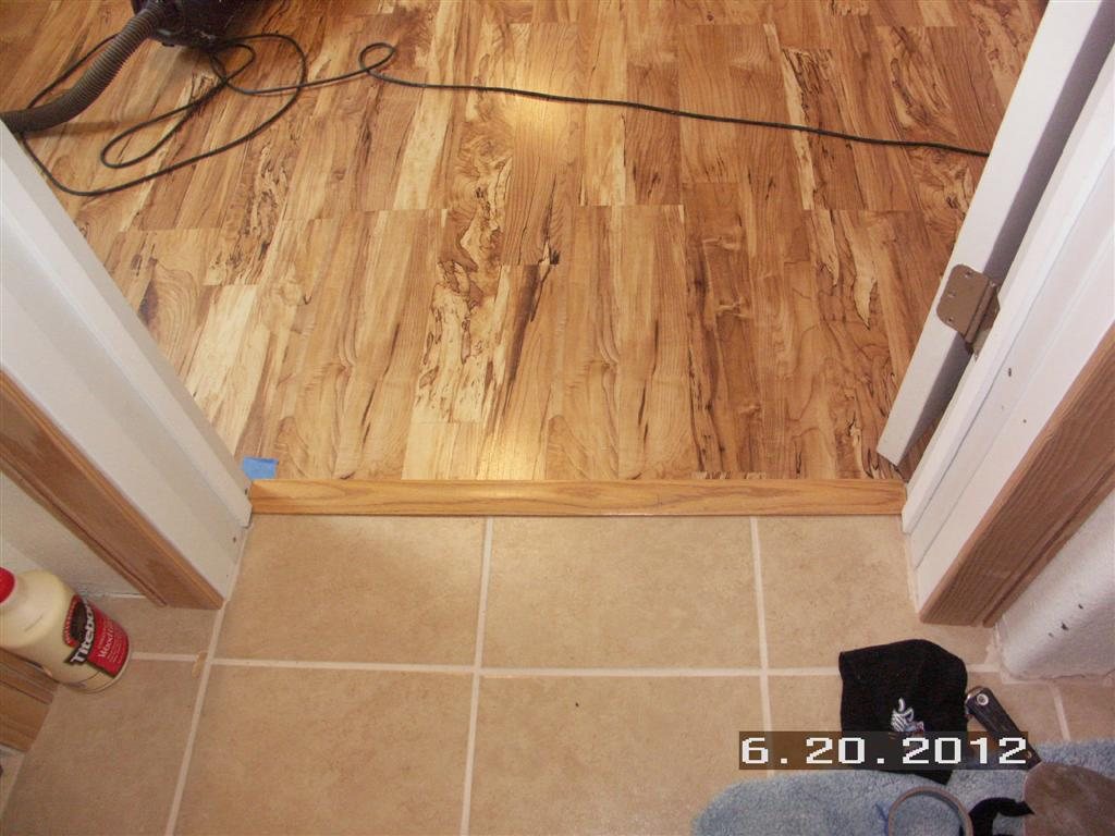 Laminate flooring transition laminate flooring hallway for Laying hardwood floors