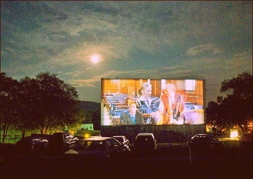 drive-in movie screen with moonlight shining upon the theater