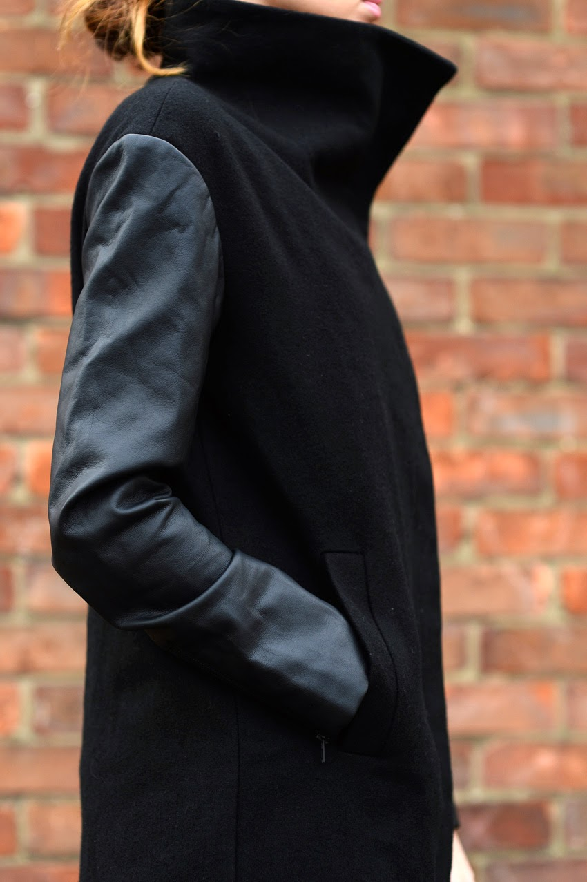 black coat with leather sleeves