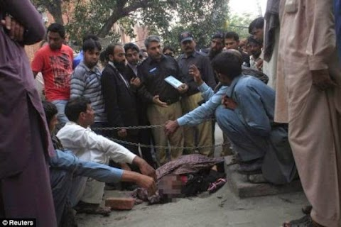 Stoned to death for marrying the man she loved: Moment PREGNANT woman was murdered by 20 members of her family - in front of a Pakistani city's high court