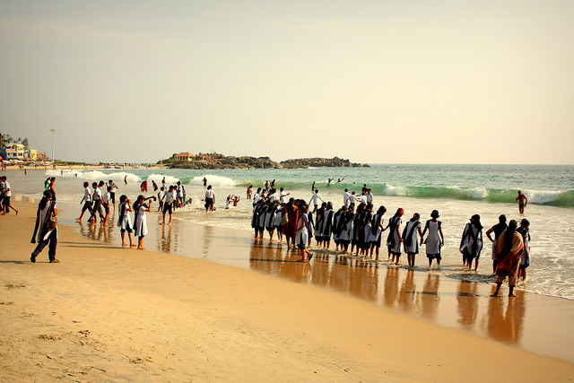 Students on beach Kovalam
