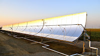 The parabolic solar panels at WaterFX's demonstration solar desalination plant in California's Panoche Water and Drainage District. (Credit: WaterFX) Click to Enlarge.