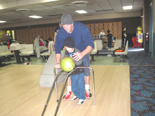 seven-year-old Dalton bowling with his dad