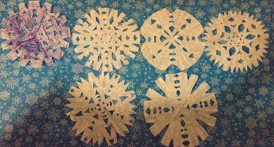 coffee filter snowflakes, Christmas craft, paper snowflakes, craft, snowflake decorations, Christmas decorations
