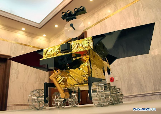 A photo taken on September 25, 2013 shows a 1: 2 scale model of Chang'e 3 moon rover. Credit: Xinhua