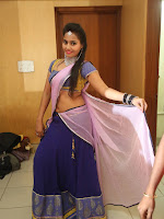 Neetha sizzling photo shoot in half saree-cover-photo