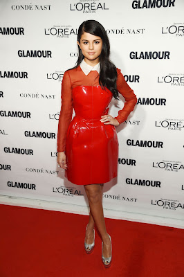 Selena Gomez wears a scarlet vinyl dress to the Glamour Women of the Year Awards