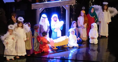 Children pose in a Christmas tableau