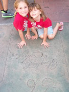 Kristy and Abby at Gramahans Chinese Theater with their handprints in the handprints of Lliz Taylor