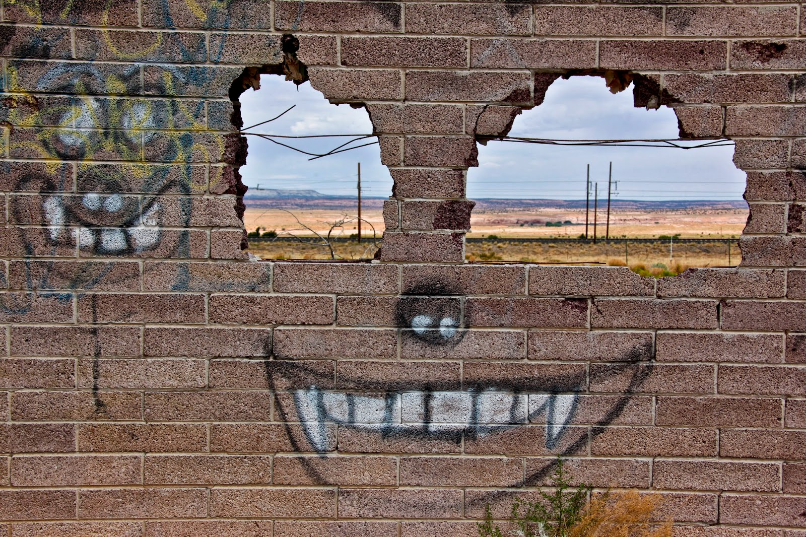 A graffiti face on one of the last standing walls of a building somewhere in Navajo Nation in Arizona.