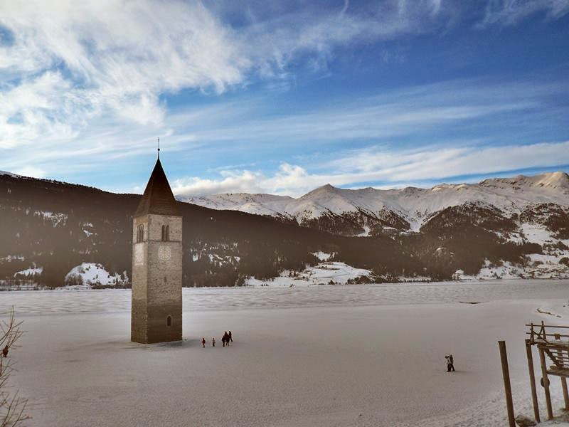 "The Campanile di Curon "" Bell Tower "" is a leftover of the old town of Curon. Its striking landmark - a steeple towering from the lake."