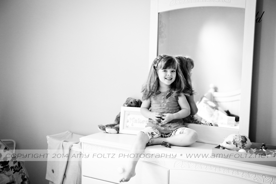 lifestyle image of preschool girl in bedroom
