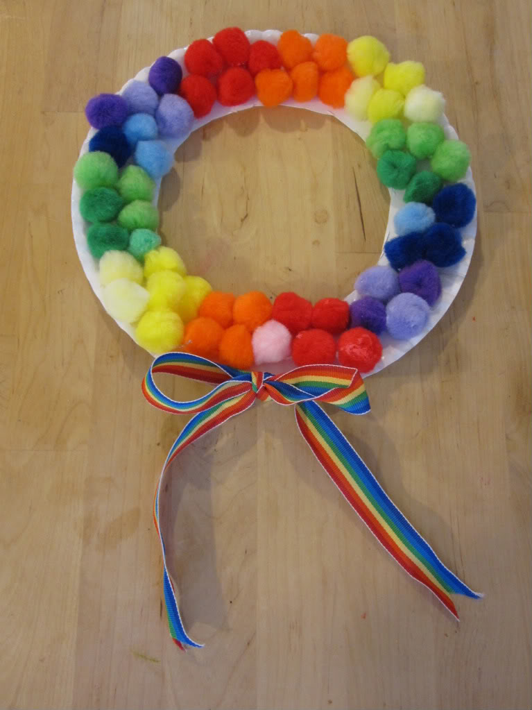 http://blogs.familyeducation.com/blogs/allison-mcdonald/rainbow-pom-pom-wreath