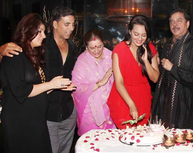 Sonakshi sinha in a gorgeous red dress cutting cake -  Sonakshi Sinha celebrates her birthday with Akshay and Prabhudeva