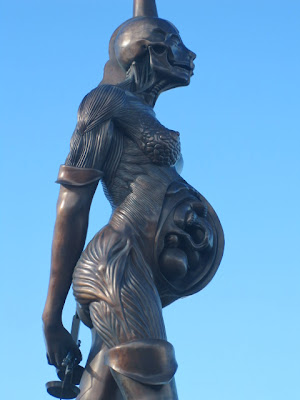 Damien Hirst sculpture of pregnant woman called Verity on Ilfracombe harbour side