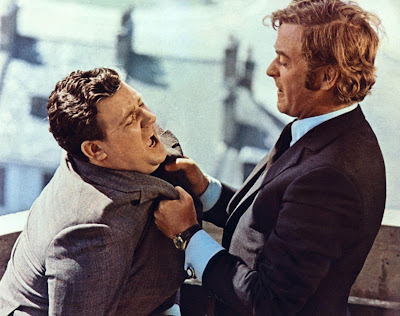 Michael Caine as Jack Carter, beats up a mafia guy, Get Carter, Directed by Mike Hodges