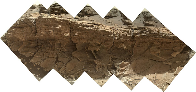 "A rock outcrop dubbed ""Missoula,"" near Marias Pass on Mars, is seen in this image mosaic taken by the Mars Hand Lens Imager on NASA's Curiosity rover. Pale mudstone (bottom of outcrop) meets coarser sandstone (top) in this geological contact zone, which has piqued the interest of Mars scientists. Credits: NASA/JPL-Caltech/MSSS"