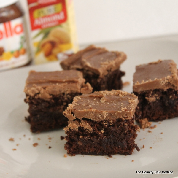 Chocolate Hazelnut Iced Brownies -- break our your Nutella and jazz up store bought brownie mix.  The addition of homemade chocolate hazelnut frosting and some almond extract in the mix will make these brownies the star of any bake sale or party.  #mccormickbakesale