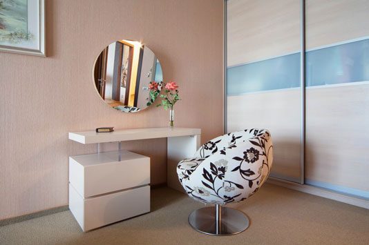modern small white dressing table with upholstered chair round mirror