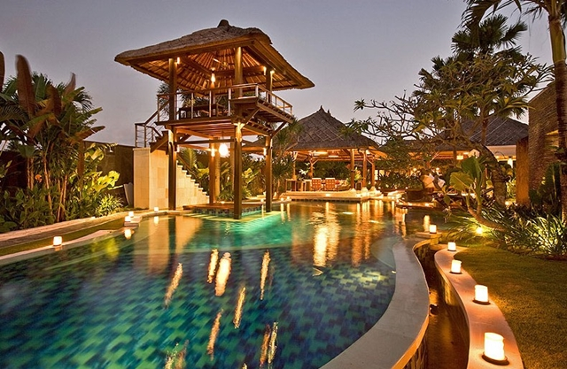Backyard of the Villa Asta, Rental Vacation Villa, Bali with the pool, trees and candles