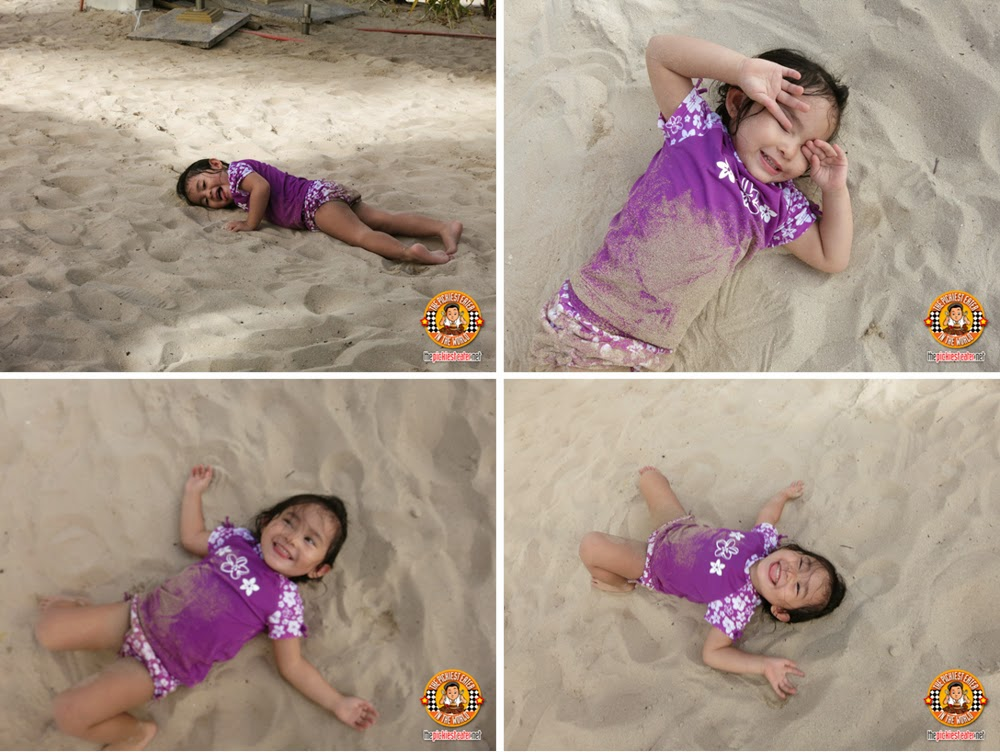 baby playing in sand