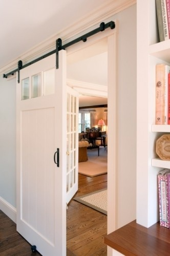 Fun stuff house dining room door decision about face for Hanging barn door in house