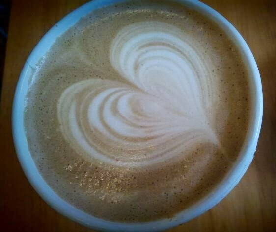 cup of coffee with froth heart