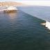 Surfeando una ola de gran extensión en Maliibú