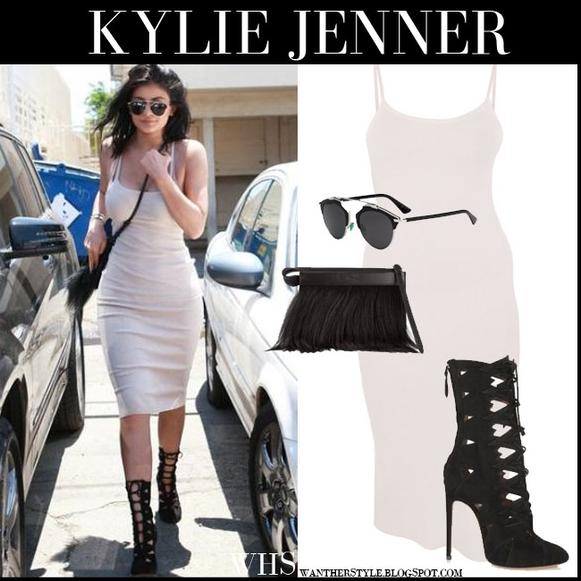 Kylie Jenner in cream bodycon dress, black fringe bag, black Dior so real sunglasses and black suede Alaia boots what she wore july 16