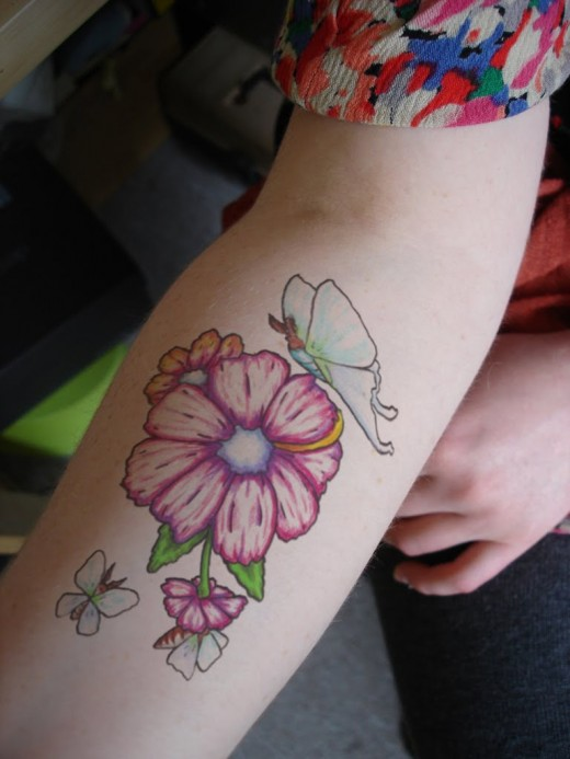Beautiful flower tattoo designs for girls and women for Flower tattoos on arm