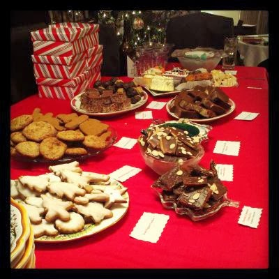 A table spread with desserts, including cookies, caramel crackers, small cakes, toffee, and Mars Bar squares