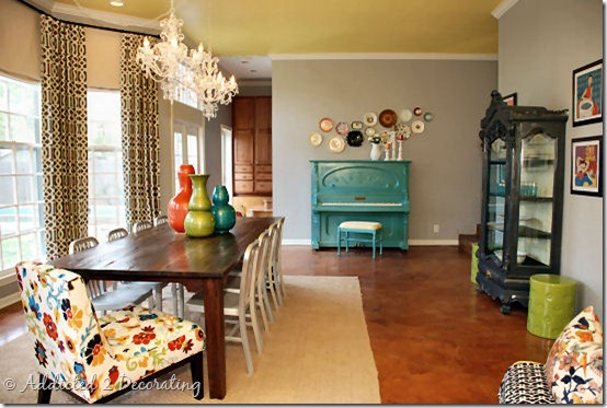 The floral chair  the windows  the drapes  the grey china cabinet   turquoise piano  the plates  the yellow ceiling  the lighting  the wood dining  table Totally Inspired Tuesday by Mallory   Classy Clutter. Piano Dining Room Table. Home Design Ideas